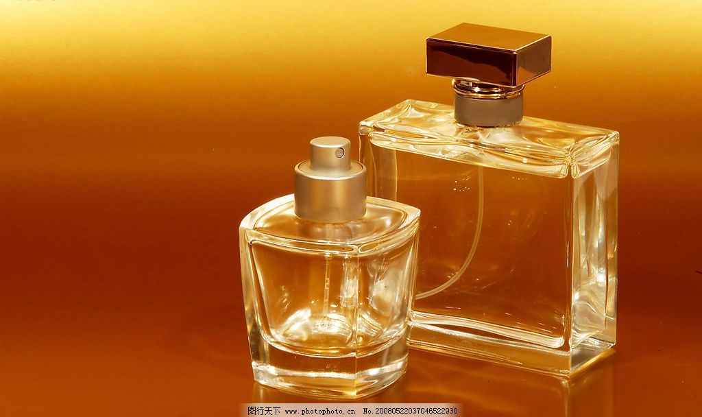 两个香水瓶 香水瓶子拱形黄色两个形状晶莹透明液体素材玻璃提手高雅